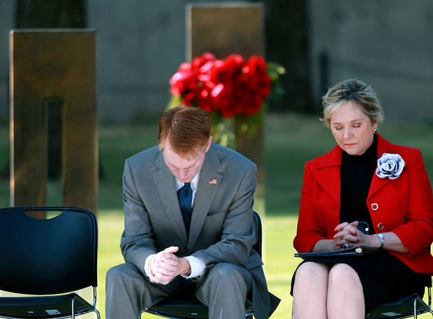 US Congressman James Lankford and Oklahoma Governor Mary Fallin bow their heads during the 168 seconds of silence during the 16th Annual Day of Remembrance at the Oklahoma City National Memorial and Museum in Oklahoma City, Oklahoma onTuesday, April 19, 2011. Photo by John Clanton, The Oklahoman