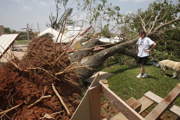 Above: Deborah Romine looks at a fallen tree May 28, 2011. Her grandmother carried the seedling in a boot from California and planted in the yard of her home in Piedmont. Photo by PAUL HELLSTERN,  THE OKLAHOMAN ARCHIVES