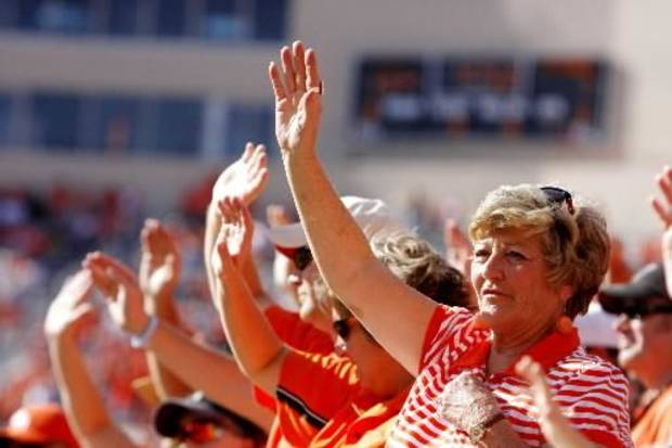 Fans wave after the Cowboys' second touchdown of the day against Iowa State at Boone Pickens Stadium in Stillwater Nov. 1. Photo by Doug Hoke
