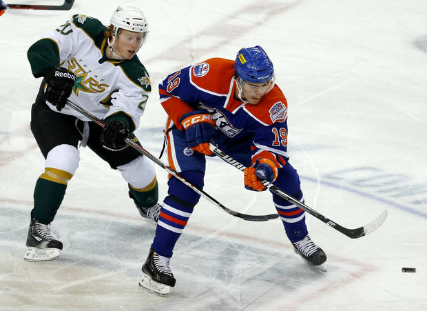 Magnus Paajarvi , at right, of the Oklhaoma City Barons skates past Cody Eakin of the Texas Stars during an AHL hockey game at the Cox Convention in Oklahoma City, Friday, Dec. 21, 2012. Photo by Bryan Terry, The Oklahoman