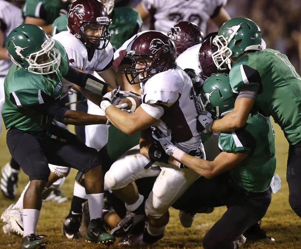 Blanchard&#039;s Braden Stringer drags several Jones defenders as he makes yardage up the middle. Blanchard vs. Jones high school football at Jones  High School on Friday, Oct. 12, 2012.   Photo by Jim Beckel, The Oklahoman