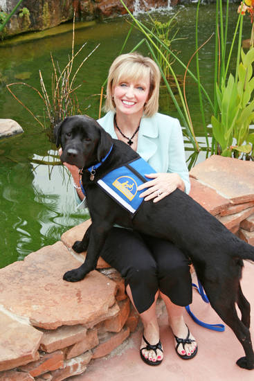 Pam Newby, executive director for Special Care Inc., sits with facility assistance dog Costa during a two-week June training program in Oceanside, Calif.  PHOTO PROVIDED BY PAM NEWBY