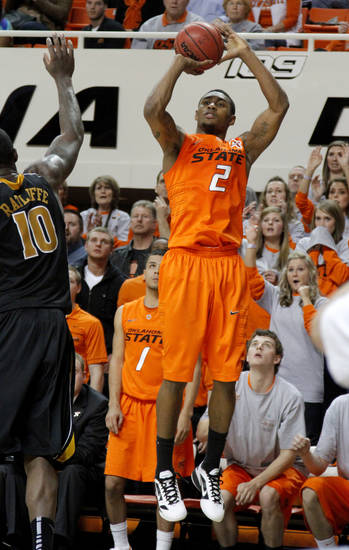 Oklahoma State's Le'Bryan Nash (2) shoots a basket as the crowd watches during an NCAA college basketball game between the Oklahoma State University Cowboys (OSU) and the Missouri Tigers (MU) at Gallagher-Iba Arena in Stillwater, Okla., Wednesday, Jan. 25, 2012. Photo by Bryan Terry, The Oklahoman