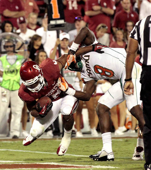 Dominique Whaley (8) scores past Brandon Denmark (8) during the second half of the college football game between the University of Oklahoma Sooners (OU) and Florida A&M Rattlers at Gaylord Family�Oklahoma Memorial Stadium in Norman, Okla., Saturday, Sept. 8, 2012. Photo by Steve Sisney, The Oklahoman