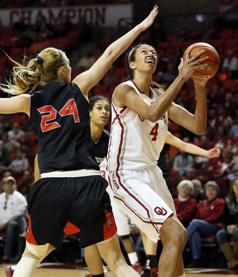Oklahoma's Nicole Griffin (4) shoots next to Cal State Northridge's Marta Masoni (24) in the first half during a women's college basketball game between the University of Oklahoma (OU) and Cal State Northridge at the Lloyd Noble Center in Norman, Okla., Saturday, Dec. 29, 2012. Photo by Nate Billings, The Oklahoman