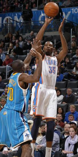 Oklahoma City&#039;s Kevin Durant (35) shoots the ball over New Orleans&#039; Quincy Pondexter (20) during the NBA basketball game between the Oklahoma City Thunder and the New Orleans Hornets, Wednesday, Feb. 2, 2011 at the Oklahoma City Arena. Photo by Bryan Terry, The Oklahoman