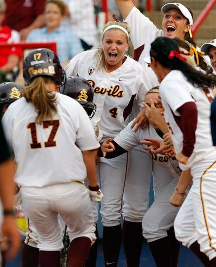 Arizona State celebrates after a home run by Katelyn Boyd (17) in the fifth inning during a Women's College World Series softball game between the University of Oklahoma and Arizona State University at ASA Hall of Fame Stadium in Oklahoma City, Thursday, June 2, 2011. ASU won, 3-1. Photo by Nate Billings, The Oklahoman
