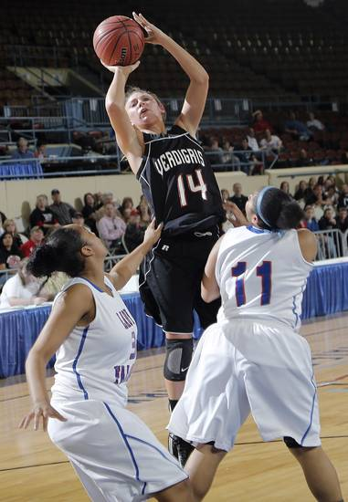 Verdigris' Courtney Risenhoover (14) shoots over Millwood's Keviona Grissom (3) and Da'Neshia Threatt (11) during the 3A girls quarterfinals game between Millwood High School and Verdigris High School at the State Fair Arena on Thursday, March 7, 2013, in Oklahoma City, Okla. Photo by Chris Landsberger, The Oklahoman