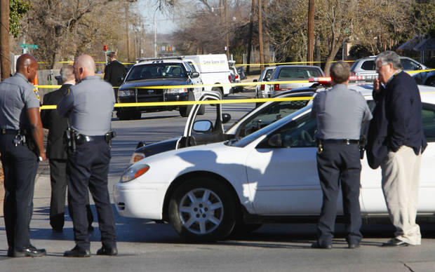 Law enforcement officers survey the scene of a police officer-involved shooting Tuesday, Dec. 18, 2012, on N Youngs Boulevard north of NW 30.    Photo By David McDaniel, The Oklahoman <strong>David McDaniel - The Oklahoman</strong>