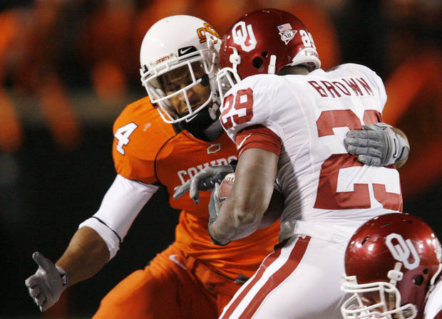 Patrick Levine of OSU stops Sooner Chris Brown during the first half of the college football game between the University of Oklahoma Sooners (OU) and Oklahoma State University Cowboys (OSU) at Boone Pickens Stadium on Saturday, Nov. 29, 2008, in Stillwater, Okla. STAFF PHOTO BY NATE BILLINGS
