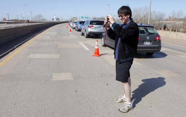 Vincent Vitner, of Okla. City, taking photos while standing in the westbound lanes of the old I-40 Crosstown in Oklahoma City Wednesday, Feb. 29, 2012. The Oklahoma Department of Transportation let folks park and walk a section of the former highway in downtown Oklahoma City. Photo by Paul B. Southerland, The Oklahoman