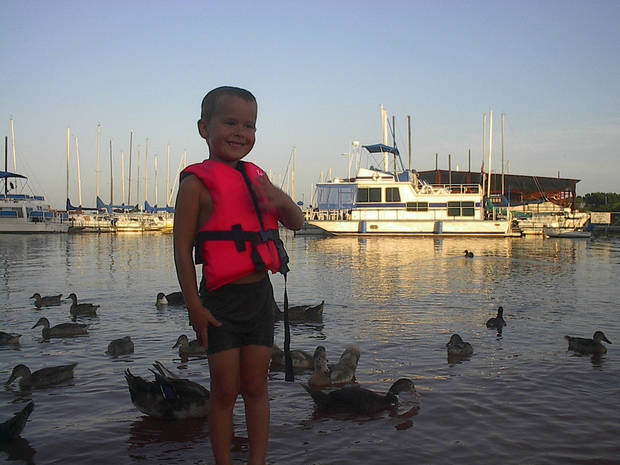 The lake and kash with the ducks ..<br/><b>Community Photo By:</b> Tama<br/><b>Submitted By:</b> Tama, Midwest
