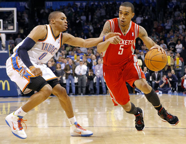 Oklahoma City's Russell Westbrook pressures Houston's Courtney Lee during their NBA basketball game at the OKC Arena in downtown Oklahoma City on Wednesday, Nov. 17, 2010. Photo by John Clanton, The Oklahoman