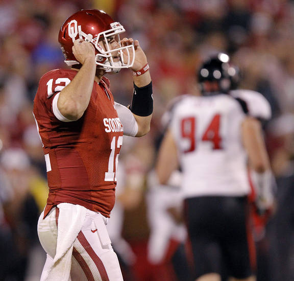 Oklahoma's Landry Jones (12) reacts after throwing an interception during the college football game between the University of Oklahoma Sooners (OU) and Texas Tech University Red Raiders (TTU) at the Gaylord Family-Oklahoma Memorial Stadium on Saturday, Oct. 22, 2011. in Norman, Okla. Photo by Chris Landsberger, The Oklahoman