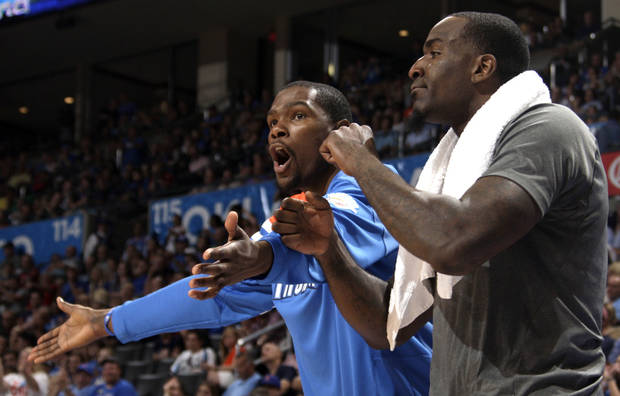 REACTION: Oklahoma City's Kevin Durant (35) and Kendrick Perkins (5) react on the bench during the NBA basketball game between the Oklahoma City Thunder and the Sacramento Kings at Chesapeake Energy Arena in Oklahoma City, Tuesday, April 24, 2012. Photo by Sarah Phipps, The Oklahoman.