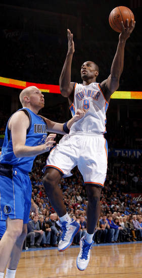 Oklahoma City's Serge Ibaka (9) goes to the basket past Dallas' Chris Kaman (35) during an NBA basketball game between the Oklahoma City Thunder and the Dallas Mavericks at Chesapeake Energy Arena in Oklahoma City, Thursday, Dec. 27, 2012.  Photo by Bryan Terry, The Oklahoman