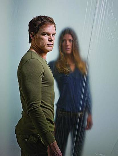 Michael C. Hall as Dexter Morgan and Jennifer Carpenter as Debra Morgan in Dexter (Season 7) - Photo: Robert Sebree/SHOWTIME - Photo ID: DEXTER7_PR04_Curtain_HimFront_4c_300