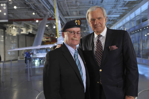 Tom Brokaw with Pat Devine, Vietnam veteran. AMC Photo by Diane Bondareff