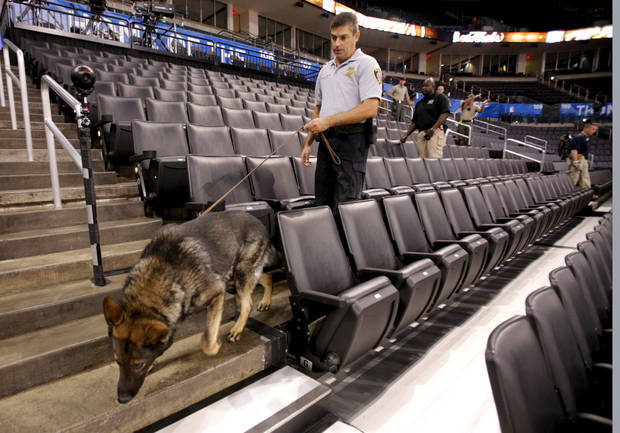 Oklahoma City Police Sgt. Kevin Reagor and Niko join four other bomb sniffing dogs in a sweep of the seating in preparation for the first game of the NBA basketball finals at the Chesapeake Arena on Tuesday, June 12, 2012 in Oklahoma City, Okla.  Photo by Steve Sisney, The Oklahoman