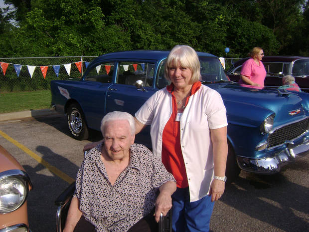 Resident Garrnett Bergstrom and employee Jan Cheek-Barela admire antique cars during a party at Grace Living Center - Brookwood during National Nursing Home Week.