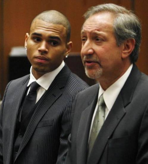 Chris Brown appears in court Aug. 25 with his attorney Mark Geragos. (AP photo)