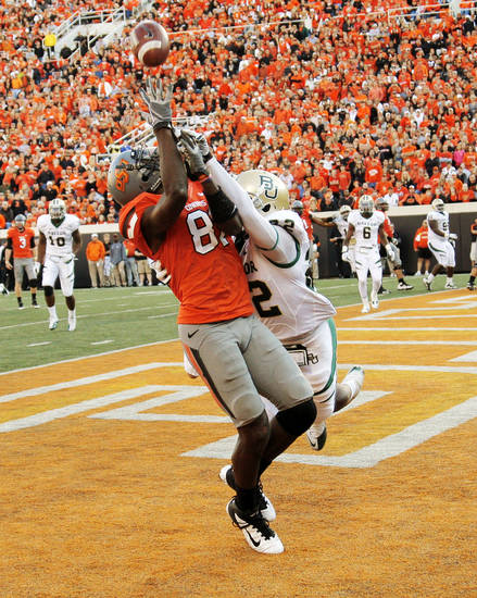 OSU's Justin Blackmon (81) catches a pass for a touchdown as Joe Williams (22) of Baylor defends in the third quarter during a college football game between the Oklahoma State University Cowboys (OSU) and the Baylor University Bears (BU) at Boone Pickens Stadium in Stillwater, Okla., Saturday, Oct. 29, 2011. OSU won, 59-24. Photo by Nate Billings, The Oklahoman
