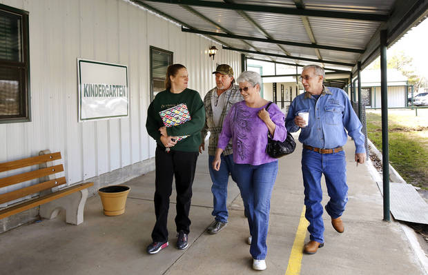 From left, Susan McGee, Richard McGee, Julie Starnes and Noel Starnes walk past a kindergarten classroom at Lane School.  About 50 students transferred to Lane Public School after their former school, Farris School, was annexed by Lane in Atoka County.   Photo taken  March 1, 2013. Photo by Jim Beckel, The Oklahoman