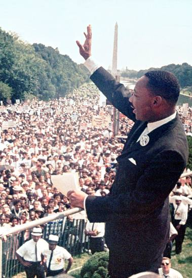 "In this Aug. 28, 1963 archive photo, The Rev. Martin Luther King Jr. waves to the crowd at the Lincoln Memorial for his ""I Have a Dream"" speech during the March on Washington. <strong> - AP</strong>"