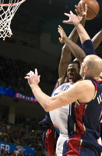 Oklahoma City's Desmond Mason, middle, is fouled during the NBA game between the Oklahoma City Thunder and Cleveland Cavaliers, Sunday, Dec. 21, 2008, at the Ford Center in Oklahoma City. PHOTO BY SARAH PHIPPS, THE OKLAHOMAN