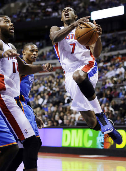 Detroit Pistons point guard Brandon Knight (7) drives to the basket past Greg Monroe (10) and Oklahoma City Thunder's Russell Westbrook in the first half of an NBA basketball game in Auburn Hills, Mich., Monday, Nov. 12, 2012. (AP Photo/Paul Sancya)