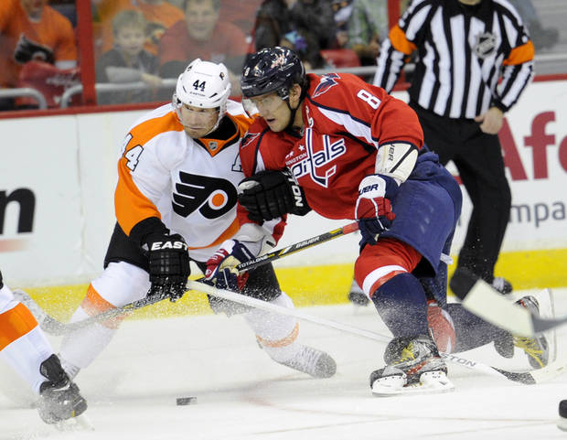 Washington Capitals left wing Alex Ovechkin (8), of Russia, battles for the puck against Philadelphia Flyers defenseman Kimmo Timonen (44), of Finland, during the second period of an NHL hockey game on Friday, Feb. 1, 2013, in Washington. (AP Photo/Nick Wass)