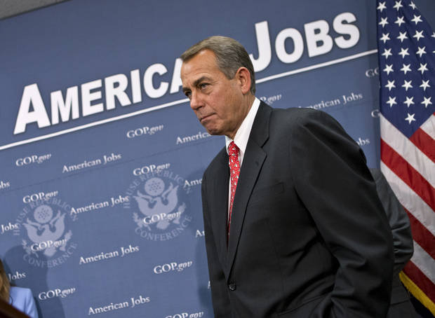 Speaker of the House John Boehner, R-Ohio, joined by the Republican leadership, speaks to reporters about the fiscal cliff negotiations with President Obama following a closed-door strategy session, at the Capitol in Washington, Tuesday, Dec. 18, 2012.  (AP Photo/J. Scott Applewhite)