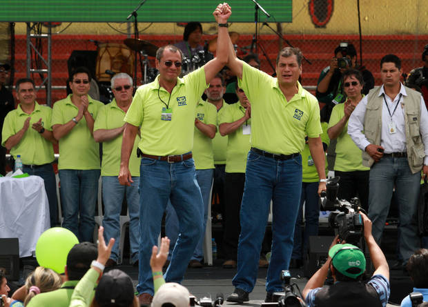 Ecuador's President Rafael Correa, right, and his running mate Jorge Glas, former minister of Strategic Coordination, acknowledge supporters at an Alianza Pais convention rally where Correa announced his re-election bid for the upcoming February election, in Quito, Ecuador, Saturday, Nov. 10, 2012. (AP Photo/Martin Jaramillo)