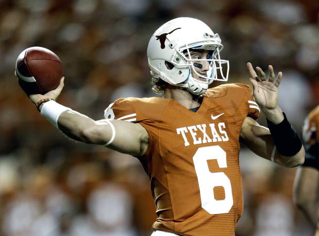 FILE - In this Sept. 8, 2012, file photo, Texas' Case McCoy looks to pass against New Mexico during the first quarter of an NCAA college football game in Austin, Texas. Texas has sent home McCoy and injured linebacker Jordan Hicks on the eve of the Alamo Bowl in San Antonio for violating team rules, a person with knowledge of the suspensions told The Associated Press. The person spoke to the AP on condition of anonymity Friday, Dec. 28, 2012, because the school wasn't releasing the names of the suspended players. (AP Photo/Eric Gay, File)
