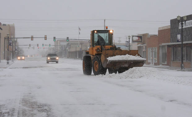 City crews remove snow early Monday, Feb. 25, 2013 in Liberal, Kan., which is under a blizzard warning until Tuesday midnight. WInds were around 25 to 30 mph by 9 a.m., with forecasts of higher winds and gusts to 5o mph in the afternoon. (AP Photo/Southwest Daily Times, Larry Phillips)