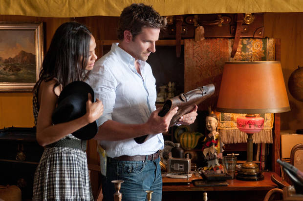 "This film image released by CBS Films shows Bradley Cooper, right, and Zoë Saldana in a scene from ""The Words."" (AP Photo/CBS Films, Jonathan Wenk)"