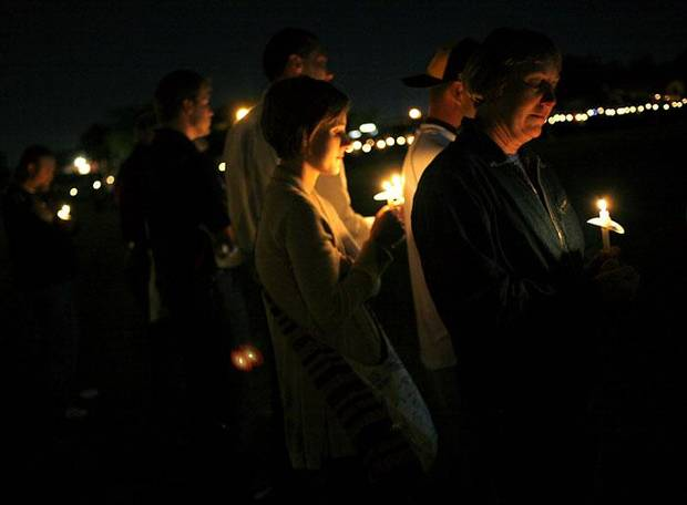 during a candlelight vigil for Coach Mike Cartmill at Santa Fe South High School's football field in Southwest Oklahoma City on Tuesday, April 27, 2010. By John Clanton, The Oklahoman