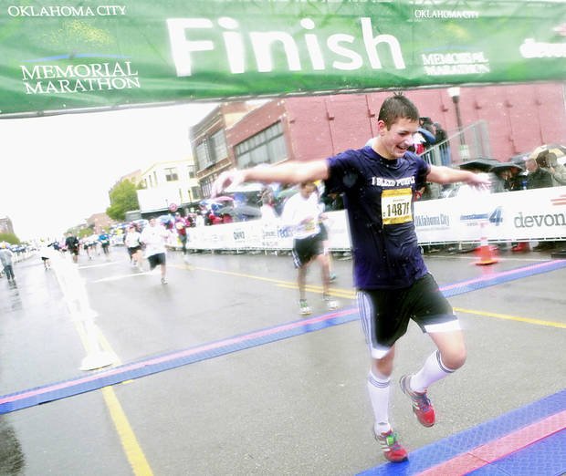 Jordan Hoehne reacts as he crosses the finish line in the half marathon during the 11th Annual Oklahoma City Memorial Marathon in Oklahoma City on Sunday, May 1, 2011. Photo by John Clanton, The Oklahoman