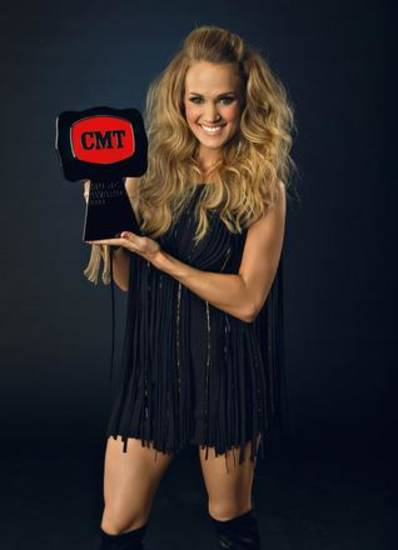 "Carrie Underwood holds her latest CMT Music Awards belt buckle, for Video of the Year for ""See You Again."" Photo provided."