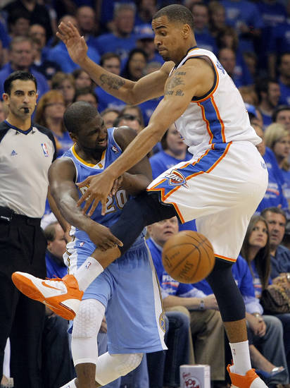 Oklahoma City's Thabo Sefolosha (2) defends on Denver's Raymond Felton (20) during the first round NBA playoff game between the Oklahoma City Thunder and the Denver Nuggets on Sunday, April 17, 2011, in Oklahoma City, Okla. Photo by Chris Landsberger, The Oklahoman