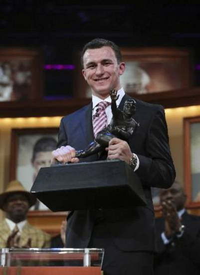 Texas A&M quarterback and 2012 Heisman Trophy winner Johnny Manziel will face Oklahoma in the Jan. 4 Cotton Bowl. AP PHOTO