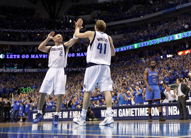 Jason Kidd (2) of Dallas and Dirk Nowitzki (41) celebrate during game 5 of the Western Conference Finals in the NBA basketball playoffs between the Dallas Mavericks and the Oklahoma City Thunder at American Airlines Center in Dallas, Wednesday, May 25, 2011. Photo by Bryan Terry, The Oklahoman