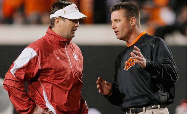 OU head coach Bob Stoops, left, and OSU head coach Mike Gundy talk before the Bedlam college football game between the University of Oklahoma Sooners (OU) and the Oklahoma State University Cowboys (OSU) at Boone Pickens Stadium in Stillwater, Okla., Saturday, Nov. 27, 2010. Photo by Nate Billings, The Oklahoman