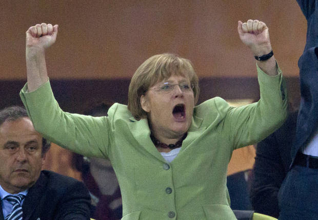 German Chancellor Angela Merkel celebrates during the Euro 2012 soccer championship quarterfinal match between Germany and Greece in Gdansk, Poland, Friday, June 22, 2012. Germany won 4-2. (AP Photo/Gero Breloer)