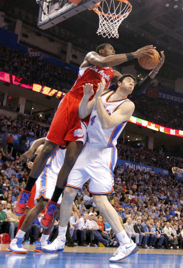Los Angeles Clippers center DeAndre Jordan (6) goes over the top of Oklahoma City Thunder power forward Nick Collison (4) for the ball during the NBA basketball game between the Oklahoma City Thunder and the Los Angeles Clippers at Chesapeake Energy Arena on Wednesday, March 21, 2012 in Oklahoma City, Okla.  Photo by Chris Landsberger, The Oklahoman