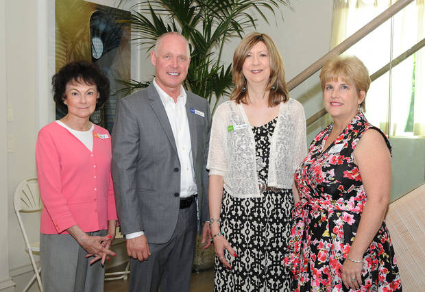 Lucy Cheatwood, Eddie Walker, Cindy Raby and Teresa Pope attend the Oklahoma Symphony Orchestra League in the home of Anna and John McMillan.
