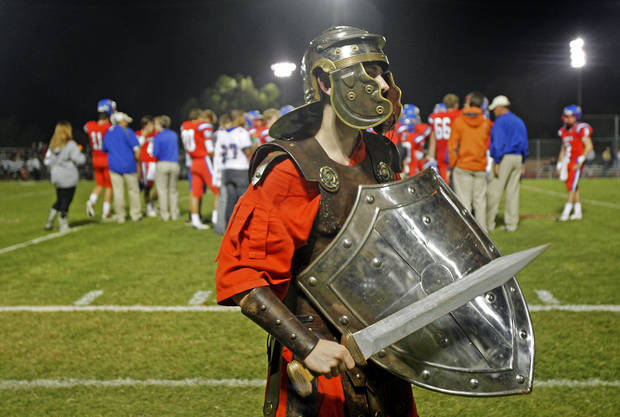 Senior Evan Lerch plays the part of Samson the Saint during a high school football game between Oklahoma Christian School (OCS) and Jones in Edmond, Friday, September 14, 2012. Photo by Bryan Terry, The Oklahoman