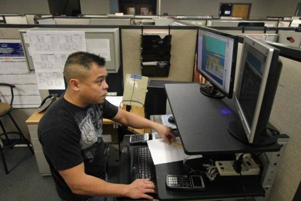 ClimateMaster Product Engineer Thinh Nguyen works at his desk in Oklahoma City , Monday, November, 2011. Photo by Steve Gooch  ORG XMIT: KOD