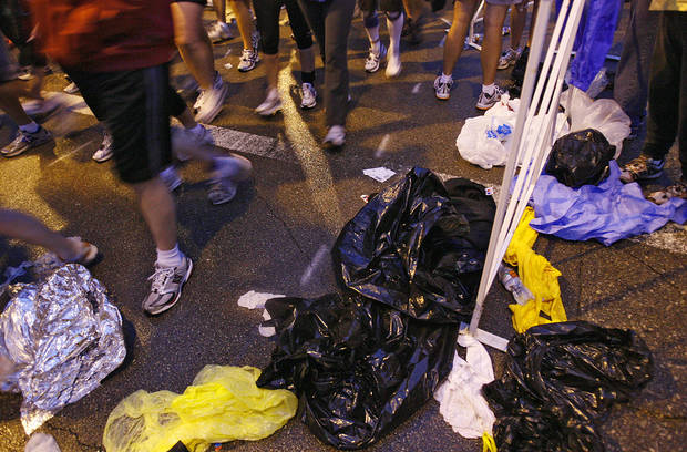 Plastic bags litter the ground after runner shed their temporary rain gear after the start of the eighth annual Oklahoma City Memorial Marathon on Sunday , April 27, 2008, in Oklahoma City, Okla.   PHOTO BY CHRIS LANDSBERGER   ORG XMIT: KOD