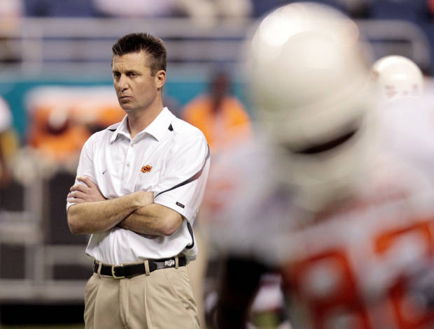 Oklahoma State coach Mike Gundy watches his team prior to the Alamo Bowl NCAA college football game against Arizona, Wednesday, Dec. 29, 2010 in San Antonio. (AP Photo/Eric Gay)